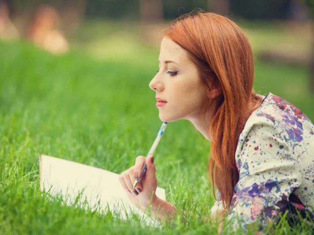 woman_writing_outside_shutterstock__medium_4x3